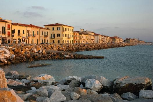 Marina di Pisa sunset view of the town's waterfront street.