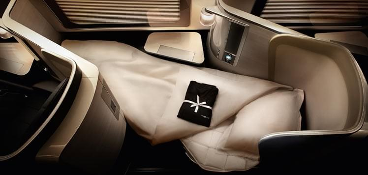 British Airways' first class includes lie-flat seats and pajamas