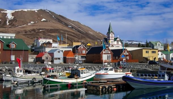 Husavik, Iceland, offers whale watching tours in an idyllic setting