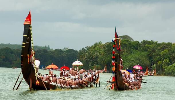 Snake boats racing during a festival in Kerala