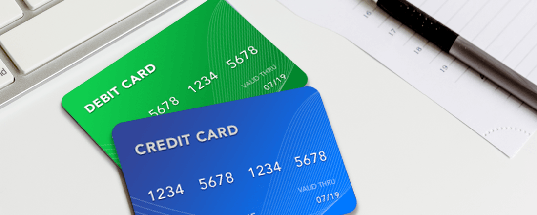 Shows two cards - debit and credit on the table