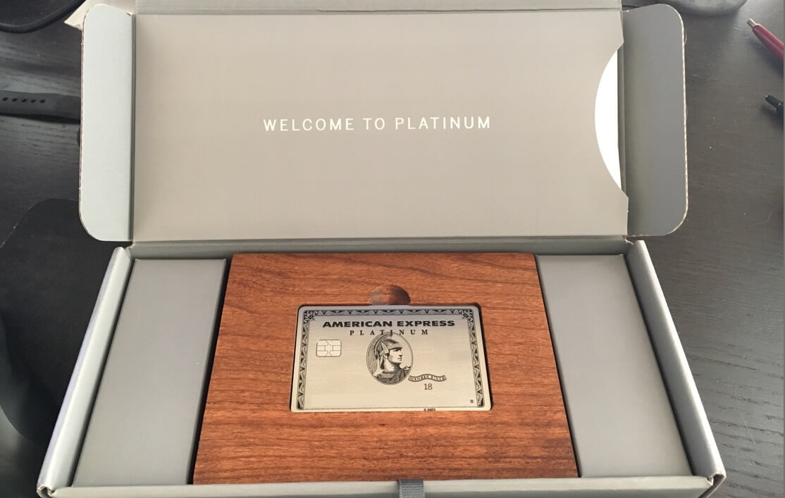 shows amex platinum card inside wooden box package