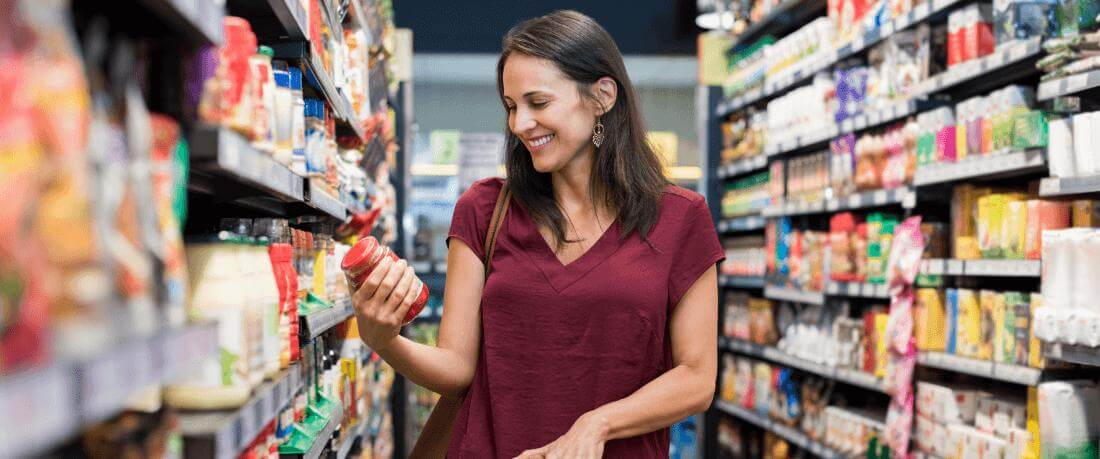 image shows woman smiling while shopping in walmart