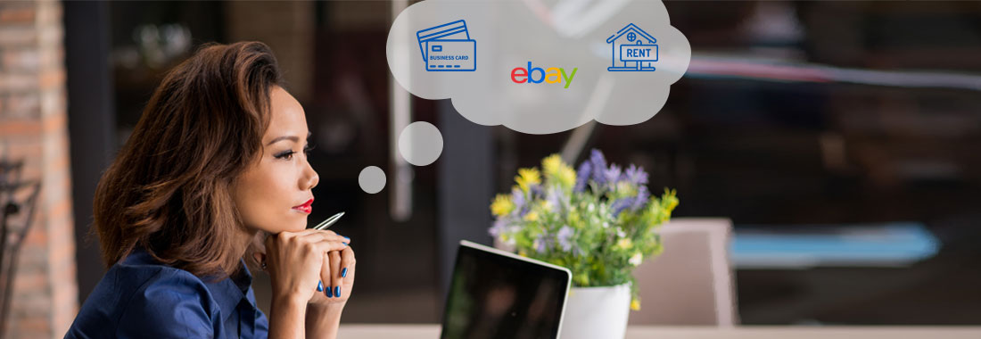 Business woman thinks about business credit card, eBay and rent business