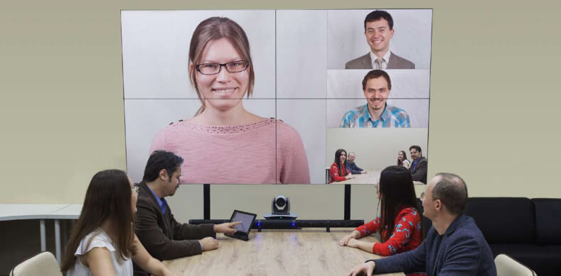 Shows people videoconferencing