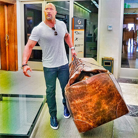 "Actor ""The Rock"" carries huge bag"