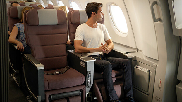 Man flying in premium class seat