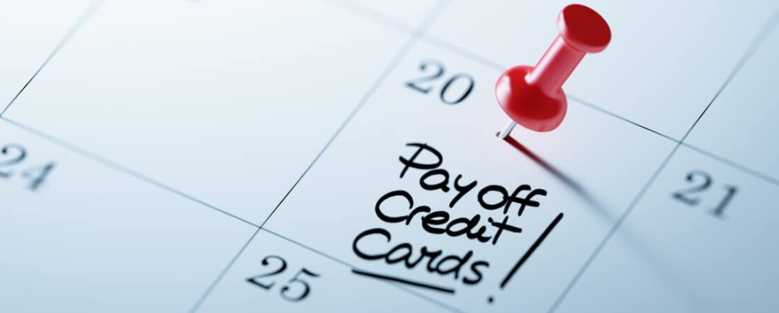 there is a calendar with checked due date for paying off credit cards